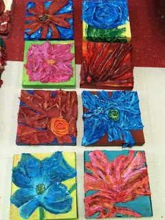 PIZZA BOX CANVAS!! (Georgia O'Keeffe)  Students dipped paper towels into glue all and sculpted it onto a pizza box creating the look of a canvas. The paper towels dry rock hard and create a 3-D flower.