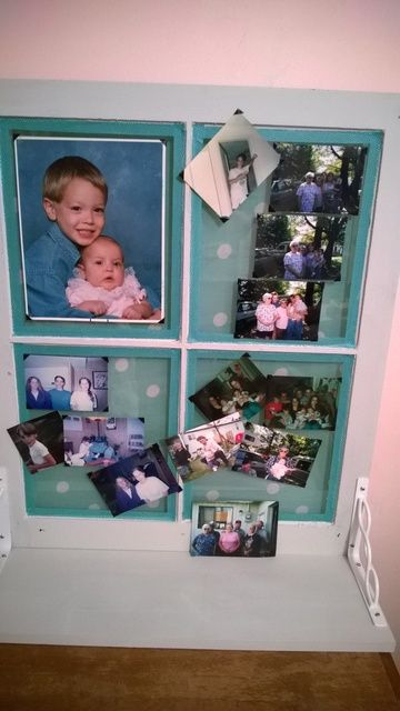 Used an old window, painted it. Backing is glued to back of window with Mod Podge for Fabric. I found a matching Washi tape in my collection and used it to frame each pane of glass. Picked up a package of photo corners and put up photo's of family. The brackets attach the window and bottom board/shelf and I had them on hand. Love the way it turned out. I will eventually add d-rings to the back to hang in my living room, but it currently sits on my night stand.