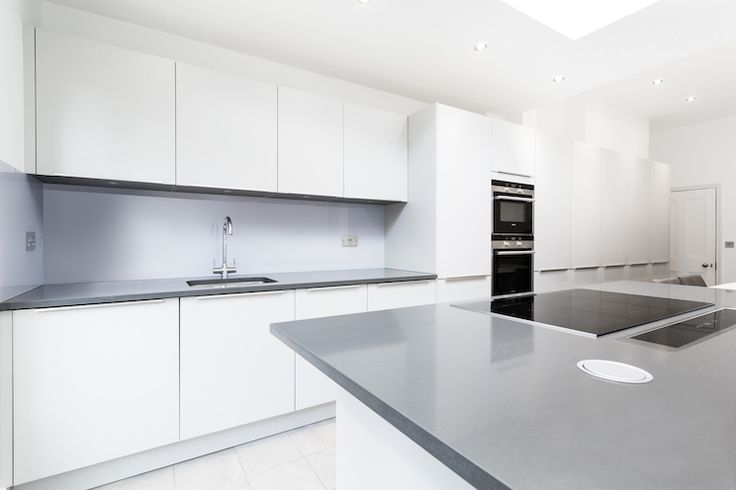 light grey kitchen with smoke grey compac quartz worktop. Black Bedroom Furniture Sets. Home Design Ideas