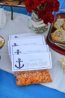 Nautical Sailing Anchor Beach Bonfire Theme Party : Shark Bait Party Favors. Just took an anchor image off of google and added some text to make these simple paper fold overs with goldfish inside. #nauticalthemeparty #sharkbait #anchor