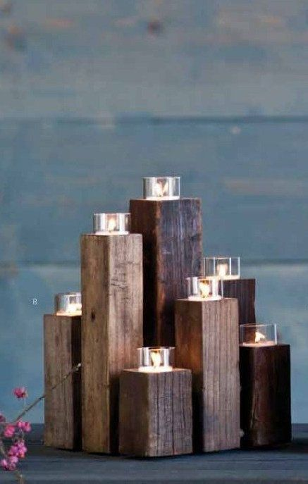 What a simple & elegant way to display tea light votives...simple, easy & cheap, just cut some 2x2s and stain
