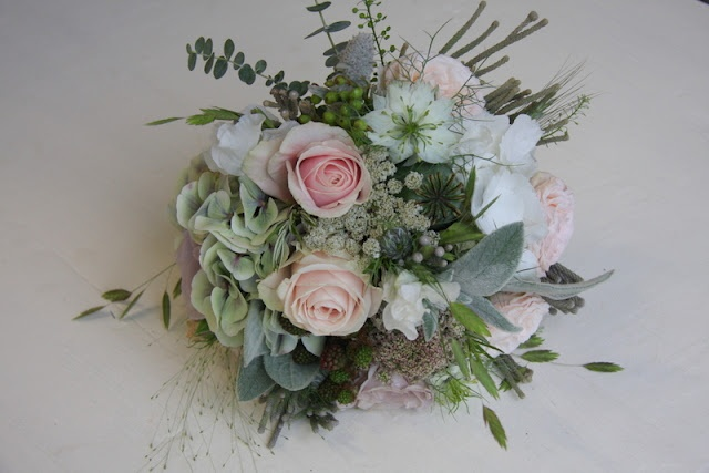 The Flower Magician: Bridal Bouquet to Tone with Silver Bridesmaid's Gowns