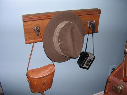 find a place to put grandpa's mailman hat, uncle larry's brownie hawkeye camera, and find an old mailbag