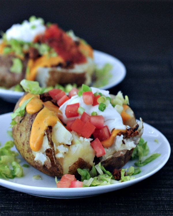 Taco Stuffed Baked Potato - a flavorful plant based taco meat and traditional fresh taco toppings melt into a fluffy baked potato - simple satisfying comfort food! @spabettie