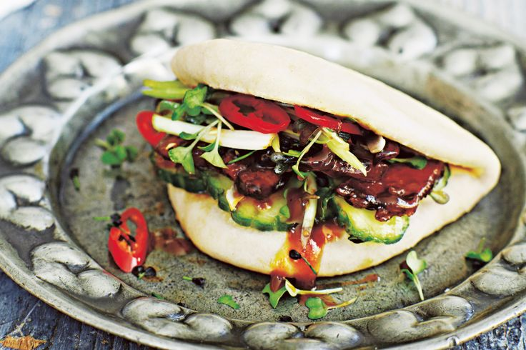 This dish by Jamie Oliver was inspired by mega chef and all-round good guy David Chang from Momofuku. These wicked buns are one of his most popular dishes – tender pork belly, simple wheat buns, pickles and sauce.