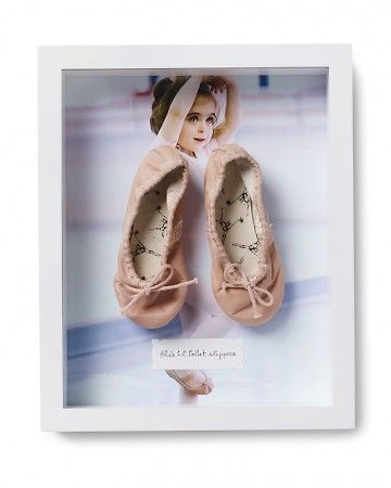 Tiny Dancer    Ella's ballet photo is enlarged to the size of the frame and backed with foam board, to which her first pair of slippers is pinned.