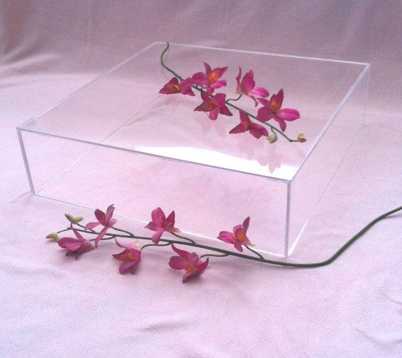 What about trying to find three glass cubes like this of different heights?