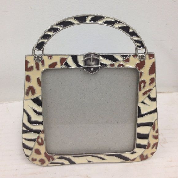 handbag Pic Frame Picture frame 5x4 measures on outside not sure what size picture fits in there. Never used it. Heavy duty frame. Very heavy in weight. Made by sunflower designs Other