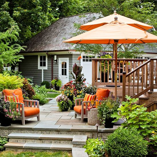 Love this extension patio off the deck + greens + flowers