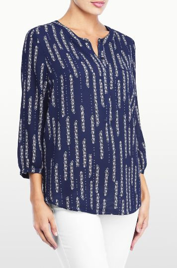 NYDJ's Printed 3/4 Sleeve Blouse features a beautiful floral Dew Drops Dark Atlantis print. Pair this flattering silhouette with your favorite NYDJ's for a stylish everyday look. With a front chest pocket, and pretty pleating at the back.
