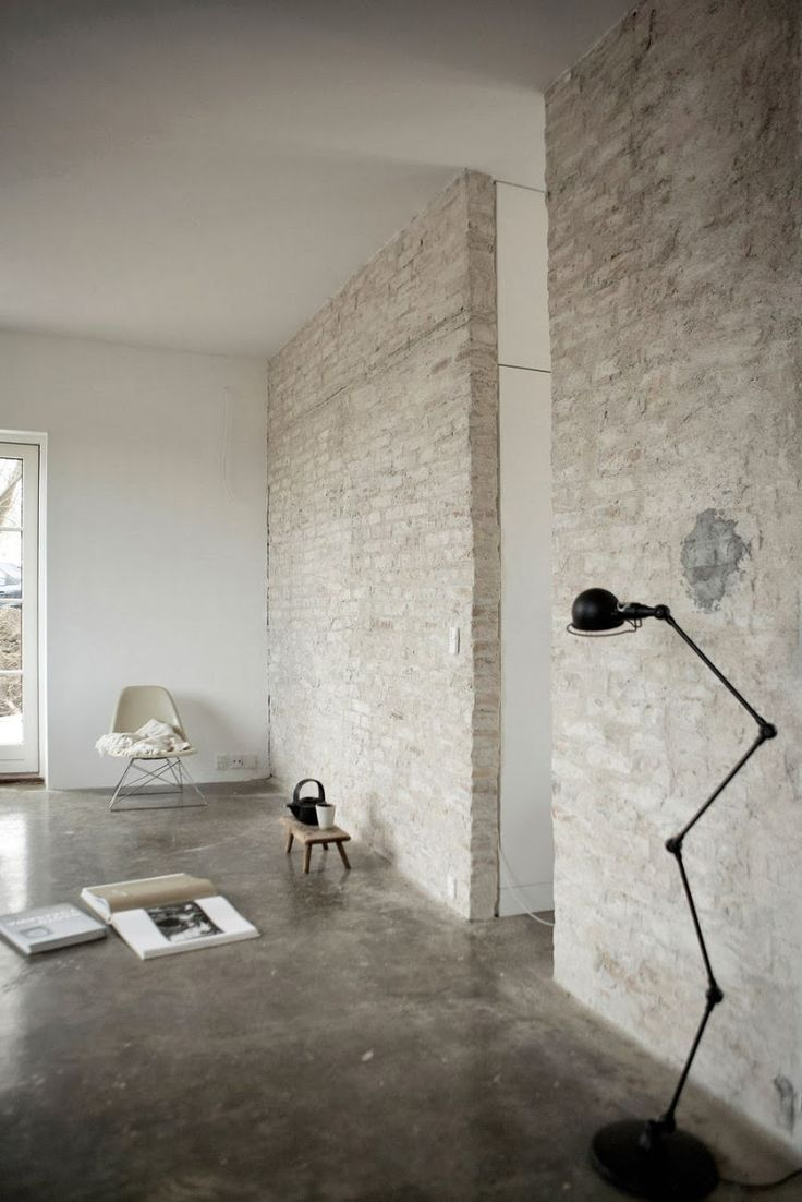 An artist's home in black, white and concrete. Original brickwork. Norm architects.