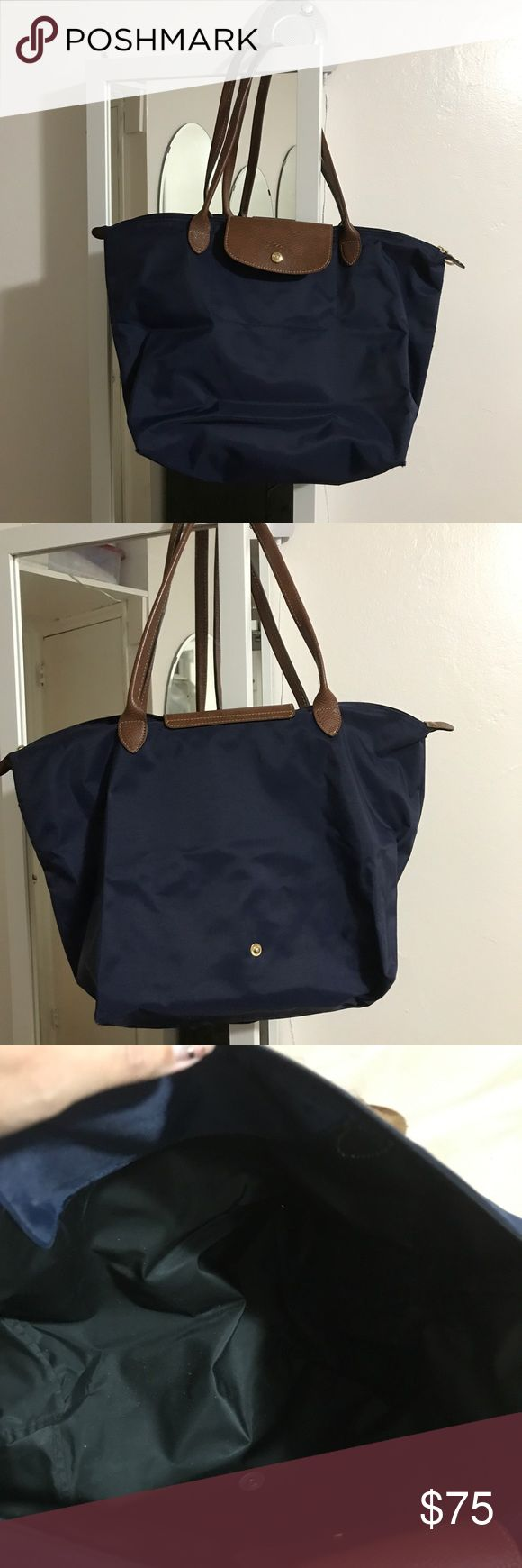 Longchamp le pliage navy blue large PRICE FIRM In great condition has no stains, peeling or marks only the corners show sign of wear as you can see in pictures I loved it but I now prefer the neo style since it's easier on my shoulders I know I changed it from medium to large cause I measured it sorry PRICE FIRM Longchamp Bags Satchels