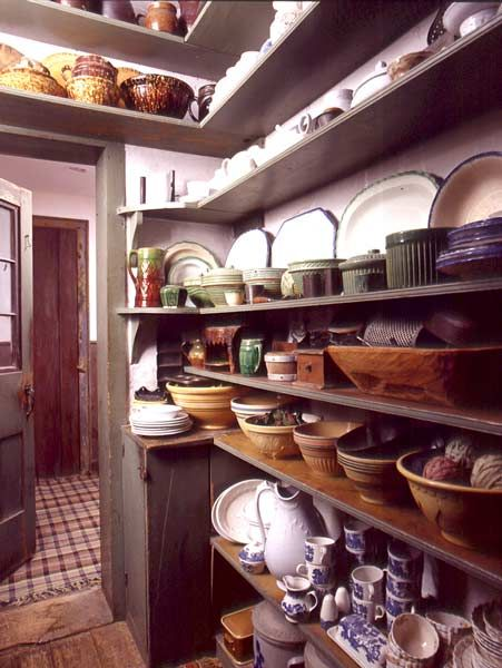 Chef Woodsman wants/needs a butler's pantry!!!    In an early house, simple painted shelves are beautiful with vintage dishware well arranged. Photo: Gross & Daley.
