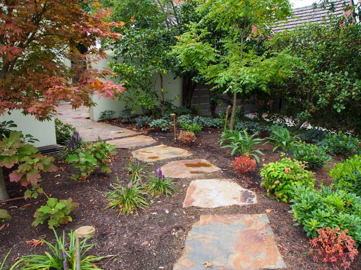 The large flag stone pieces of Titian brown were separated from the rest of the stock and used as stepping #stones for this garden path.