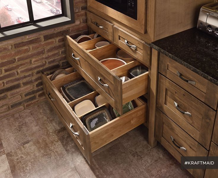 Kitchen storage that makes every pot, pan, dish, bowl and small-specialty-appliance-with-obscure-single-use feel welcome. (Rustic Alder cabinets in Husk Suede)