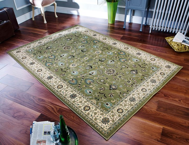 Looking for a cool floral rug with a traditional touch to it, here is the stunning Kendra Rug for your room. #traditionalrugs #floralrugs #largerugs #traditionalrunners #greenrugs #greentraditionalrugs
