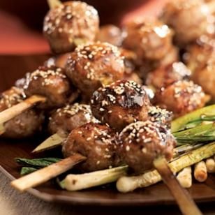 Japanese Chicken Meatballs (Tsukune)  Chicken meatballs called tsukune are a Japanese-restaurant favorite—they're essentially a chicken sausage mixture flavored with garlic and ginger. Use flat sword-shaped skewers instead of traditional round bamboo skewers to keep the meatballs from slipping when you try to turn them. Serve with bowls of steamed rice on the side.