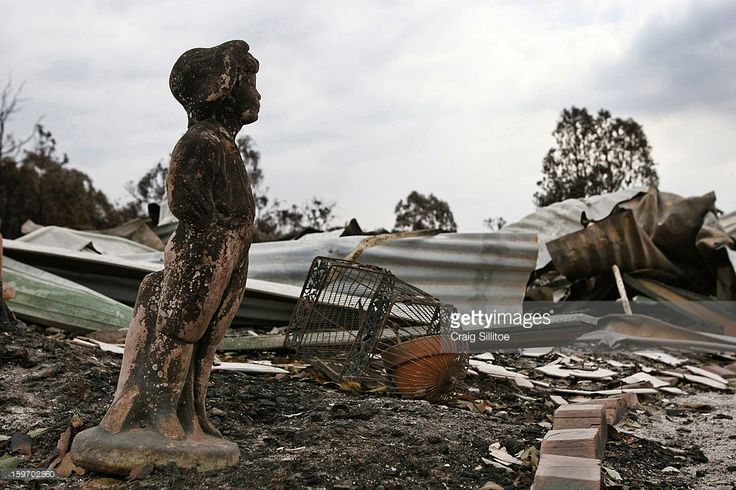 http://media.gettyimages.com/photos/charred-statue-sits-among-debris-after-a-fire-in-the-town-of-seaton-picture-id159702560