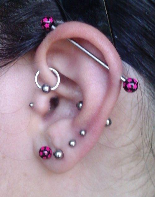 cute ear pierceings   another popular ear piercings types is helix piercing this piercing