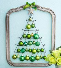 Christmas tree made from wire, old frame and green ornaments