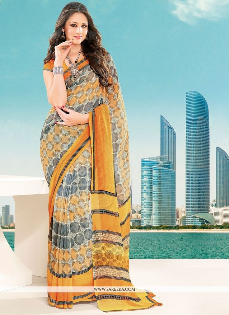 You are confident to make a powerful fashion statement with this multi colour georgette casual saree. The interesting lace and print work all through the attire is awe inspiring. Comes with matching b...