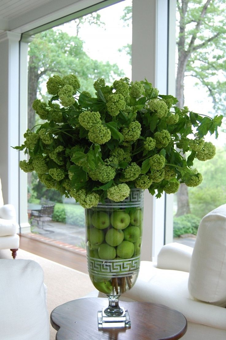 Nice flower arrangement with apples in the vase. I like the vase too.