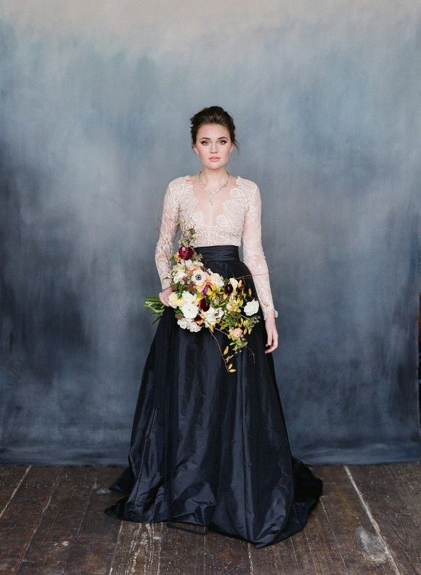 VALENTINA white lace and black stain wedding dress with long -sleeves - beautiful styling - love the ombre backdrop and the splash of mid - colour via the flowers.
