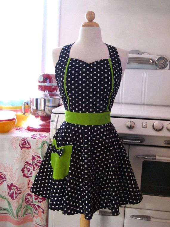 This is a vintage inspired full apron with a sweetheart neckline and tulip shaped pocket! This apron is in a black and white polka dot. The pocket and straps are a solid lime green.