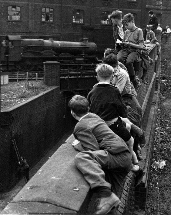 Train spotting by young boys in Birmingham Warwickshire England. Long before electronic games.