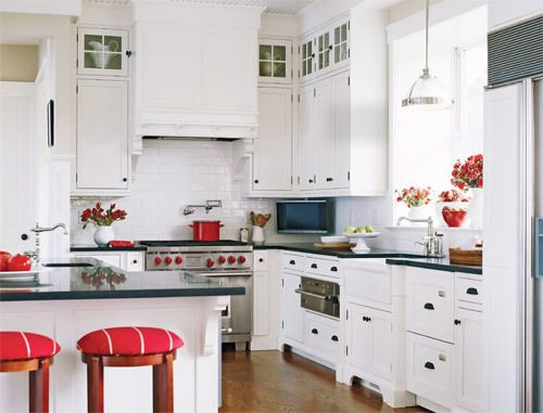 black and white kitchen with a pop of red and it looks fantastic.
