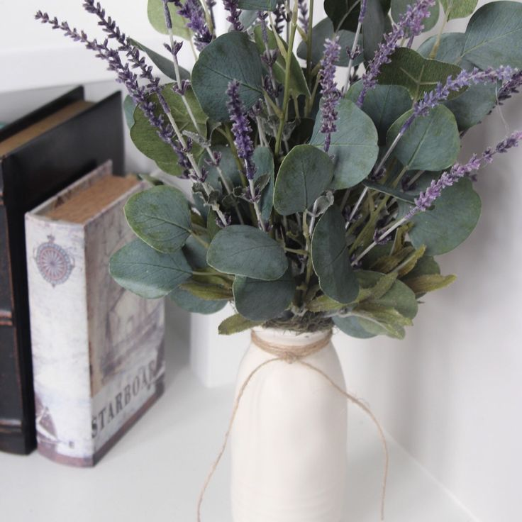 Lavender and eucalyptus in a ceramic milk bottle