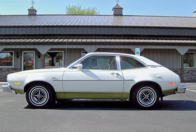 1974 Ford Pinto.. epic!  My First Car, but it was Light Blue   with dark blue trim.