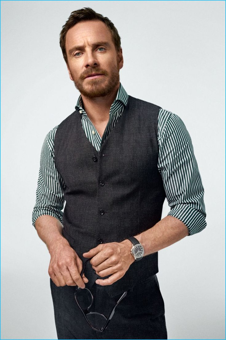 Actor Michael Fassbender wears a shirt and suit by Dolce & Gabbana. Fassbender also sports a Patek Philippe watch with Dom Vetro sunglasses in hand.