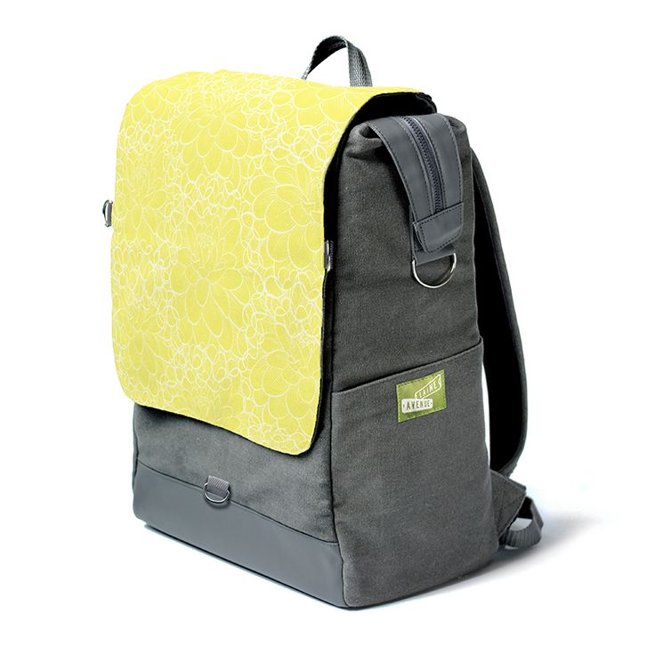 The lemon flower is oh so sweet. You are looking at the most unique backpack on the whole entire planet. Really. It's roomy. It holds all your stuff with our widemouth zip top. It protects your laptop or tablet with a padded sleeve, and best of all, The Crossbody Convertible Flap zips off to become a purse, (with the included cross body strap) for when you need just a few of your favorite things things and not all your stuff.