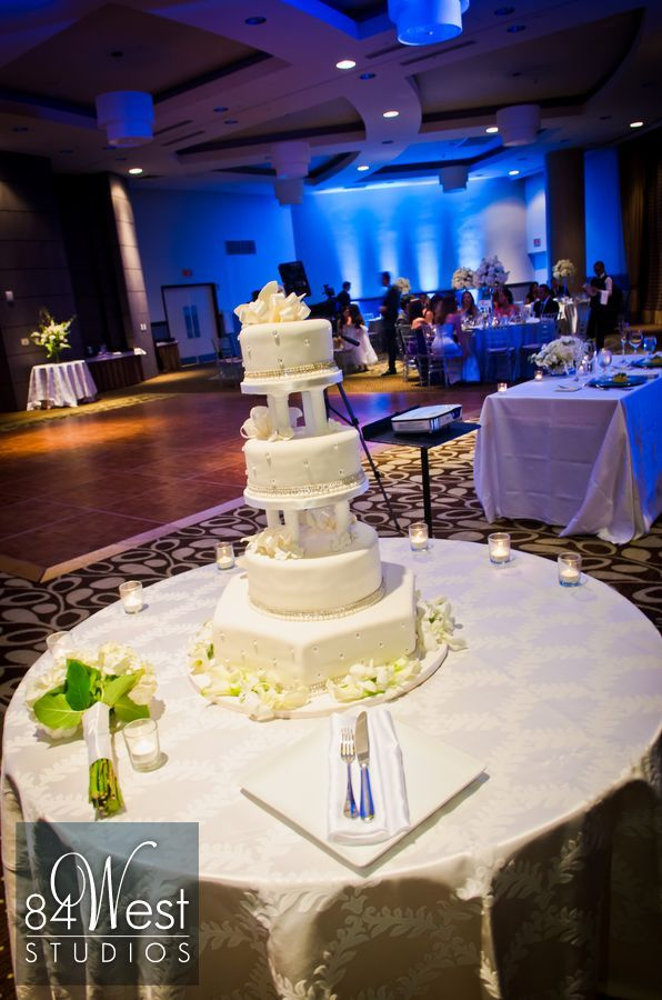 Pretty #weddingcake and blue wedding uplights at @Trump International Beach Resort #weddingphotography by 84 West Studios