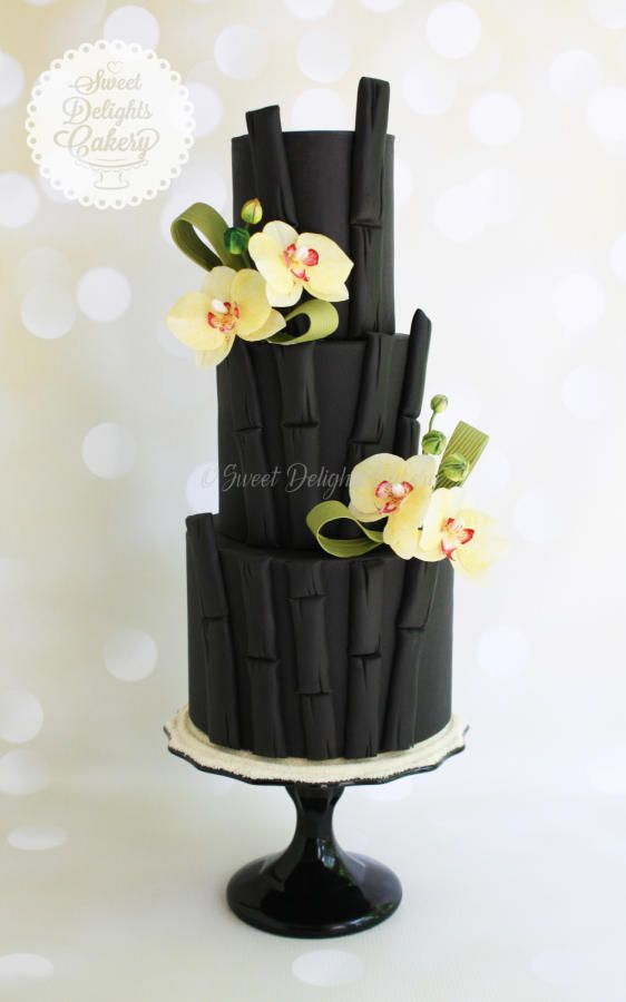 Black Bamboo Orchid Wedding Cake by Sweet Delights Cakery - http://cakesdecor.com/cakes/211349-black-bamboo-orchid-wedding-cake