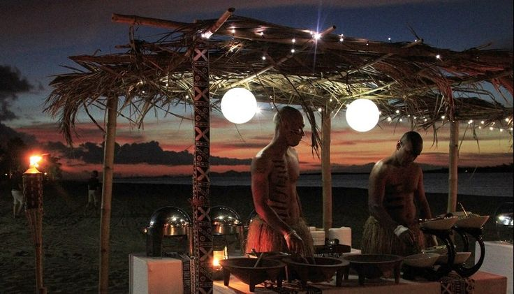 Fiji Beach Resort & Spa Managed by Hilton - Fijian men cooking at night - fiji Buffett night Saturday