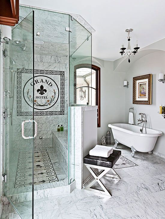 Think outside the box when including a seat in your walk-in shower. This walk-in shower's glass-top knee wall curves outward to provide space inside the shower for a commodious marble-clad bench. The partial wall also provides privacy for bench sitters enjoying water cascading from the showerhead mounted on the opposite wall./