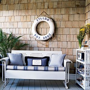 Dress up outdoor furniture with blue-and-white upholstery. The palette works just as well on woven and teak pieces as it does on vintage metal.