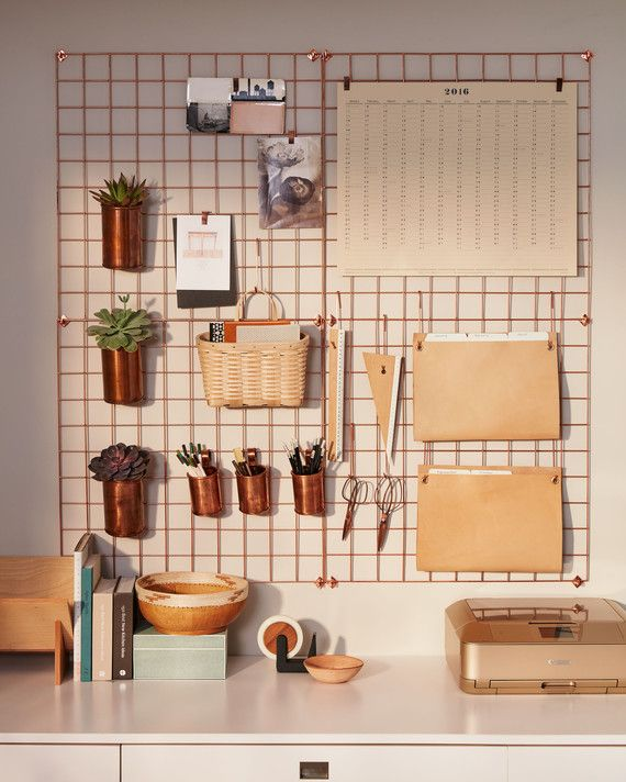 To keep your desktop uncluttered, hang supplies and folders from hooks and clips on an easy access grid. Urban Outfitters wire wall grids, in Copper (4 shown), $59 each, urbanoutfitters.com. Lostine copper cups, $30 for small and $45 for large, lostin
