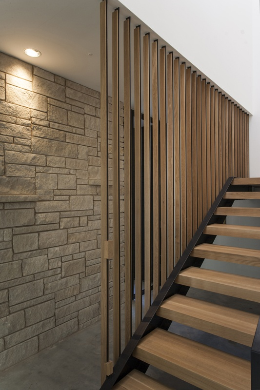 Wood And Steel Vertical Slats Along Stairway Stairs