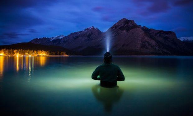 PAUL ZIZKA wears his head torch in Communion, Lake Minnewanka, Banff National Park, Canada.