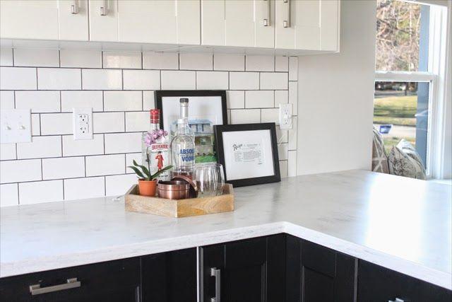 Two toned kitchen with corian rain cloud countertops