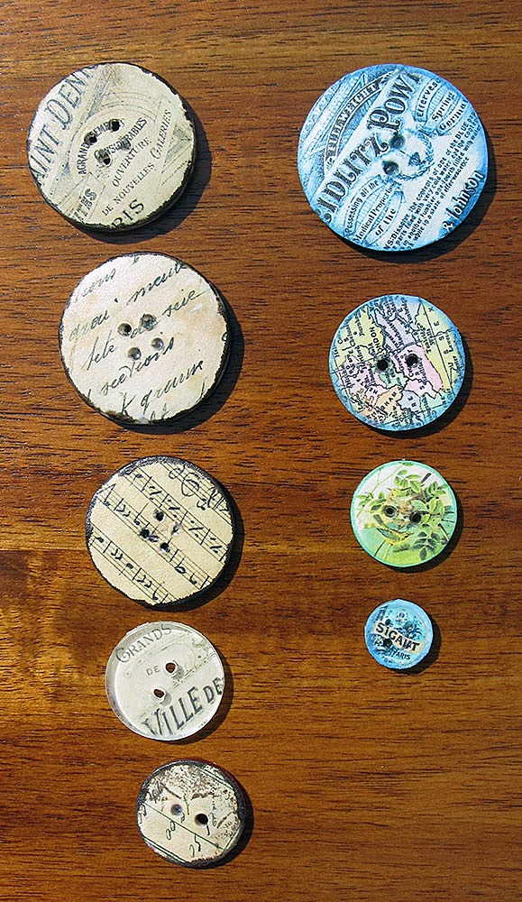 Ephemera Art Buttons as seen in Cloth, Paper, Scissors magazine.  She used clear plastic buttons and Decoupaged Vintage Ephemera Graphics to the back of them
