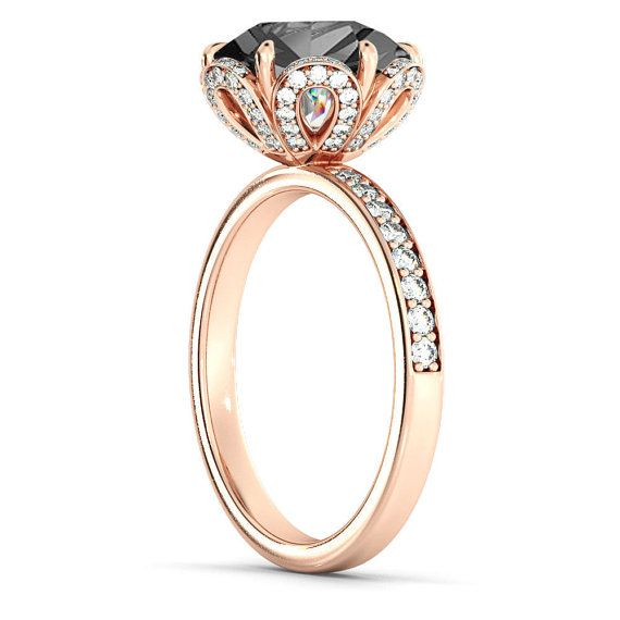 A beautiful handmade engagement ring made of 14K Rose Gold set with a Black Diamond This ring can be set with any stone you choose or in any carat