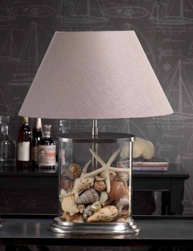 Fill Lamp. A lamp that changes with the seasons. Fill the clear glass lamp base with seashells for the Summer or to accent your beach style. The unique oval shape takes up less space on an end table or night stand.