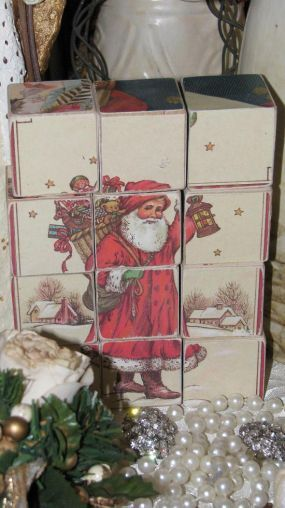 Christmas Card Block Puzzle  --  Use old Christmas cards and glue them onto wooden blocks. There are six different puzzle pictures.