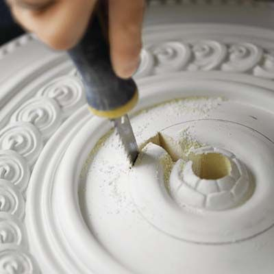 cutting a ceiling medallion.