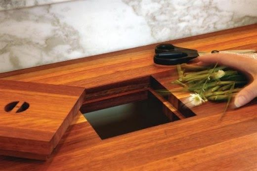 counter top trash chute/hole. have a pull-out trash can on wheels underneath to pull around the kitchen.