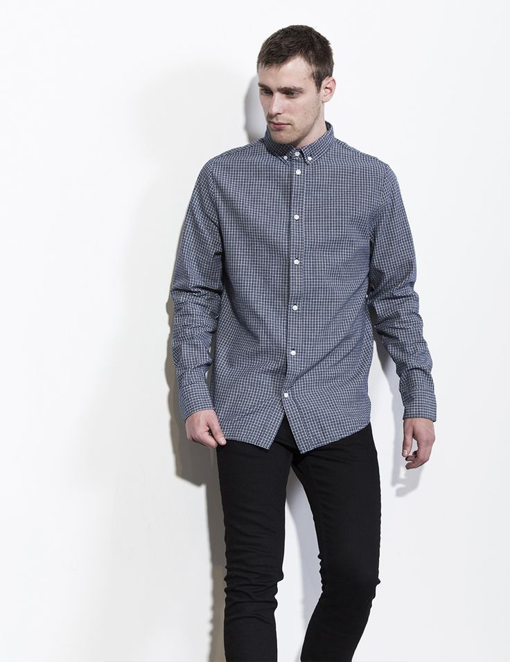 RVLT - men's fashion. A button down shirt in a two-colored indigo dyed checked cotton fabric.